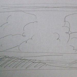 車から見た上が崩れた積乱雲
